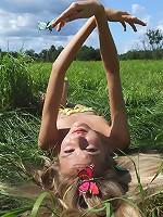 Petite teen model poses.