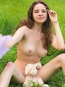 Naked teen posing