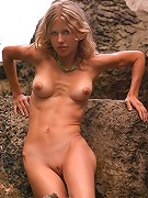 Zemani.com Liza - Cute slim sun-burnt blond with appetizing breast poses nude on the sea rocks.