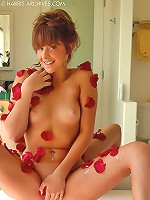 Stunning Kinzie Kenner rubbing rose petals over her naked gorgeous body and spreading her pink cherries on the showers