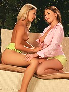 Zara and Candie - Sizzling lesbians undress and lick