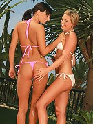 Carie and Natali - Stunning teens in bikinis get wet