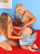 Avril and Rikki - Slender hotties undress and dildo