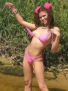 Brunette teen shows off wet pink panties