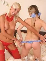 Two naked blonde teens play in their bedroom