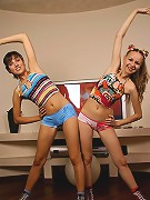 Two hot teens perform their daily exercises - naked