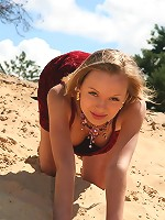 Petite blonde teen gets naked at the beach
