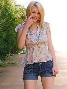 Lovely blonde Bree Daniels on the park teasing and posing in her lustry floral dress and shorts
