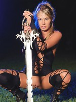 Babe posing in the knight boots and with a huge sword