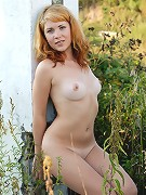 Redhead with small tits posing nude in the sunset