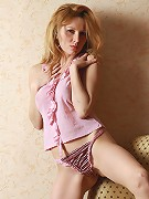 Blonde teen Yara takes off her pink panties and shirt