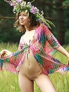 Beautiful small breasted teen posing nude on the meadow
