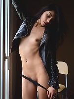 Antoinette exudes a lusty swagger wearing a black leather jacket and an intense gaze in her eyes.