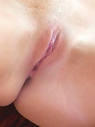 Bella C rubs her large natural tan breasts just before making herself cum with her new glass dildo