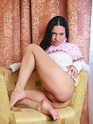 Full breasted brunette babe in a sweater bottomless