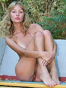 Tanlined curly blonde skinny babe